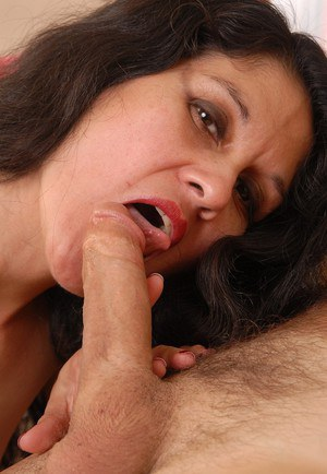 Skinny older woman Carmen giving a handjob and swallowing cum