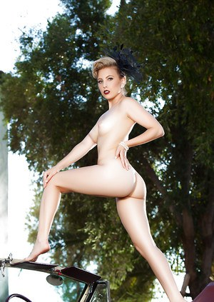 Blonde pinup model Chanel Elle striking sexy topless poses outdoors