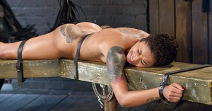 Short haired black girl Skin Diamond receiving painful flogging of buttocks
