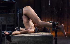Ebony chick Nikki Darling gets anally abused in straight-jacket