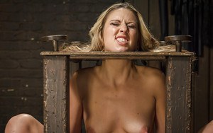 Blonde cutie Dallas Blaze tit and pussy tortured in bondage box