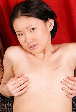 Petite Oriental first timer Dia removing leather boots for nude modeling