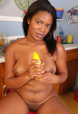 Chubby ebony lady Annabelle masturbating with sexy toy after undressing