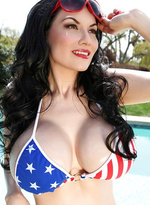 Bosomy centerfold model Dahlia Dark releasing big knockers from bikini