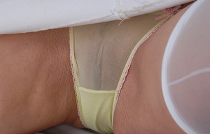 Chesty older blonde Kayla Kupcakes flaunting huge hooters in stockings