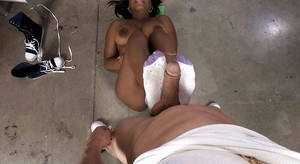 Gonzo action with ebony chick Nikki Drake using barefeet to give footjob