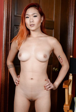 Redheaded Asian first time solo girl Lea Hart spreading shaved snatch