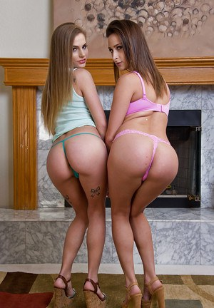 Lesbian teen pornstars Ashley Adam and Sydney Cole flaunt nice asses