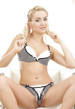 Blonde Euro babe Victoria Puppy freeing small breasts from brassiere