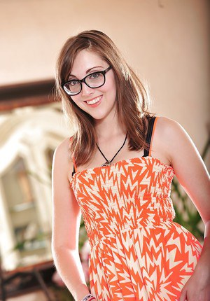 Glasses attired solo girl Nickey Huntsman spreading hairy twat in pantyhose
