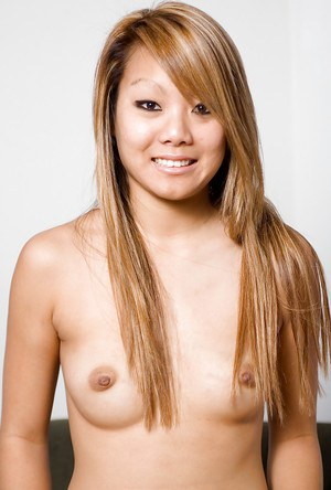 Asian amateur Kandy spreading shaved babe pussy after undressing