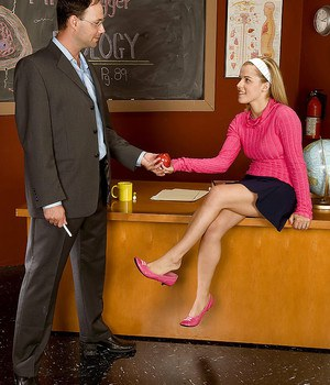 Blonde student Charlie Lynn giving footjob in office while masturbating