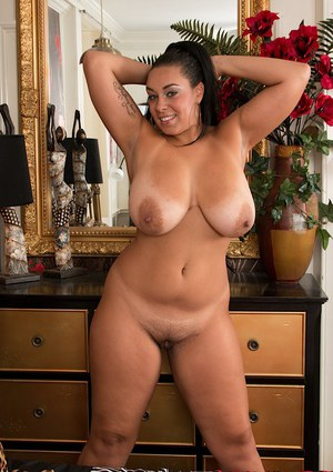 Black fatty Anastasia Lux exposing big boobs and ass for solo girl shoot