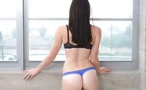 Glasses clad amateur solo girl Kymberlee Anne showing off phat ass in thong