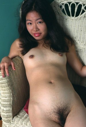 Amateur Asian solo girl Ivy baring small tits and spreading hairy pussy