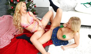 Mom and teen lesbian anal sex and pussy licking in front of Christmas tree
