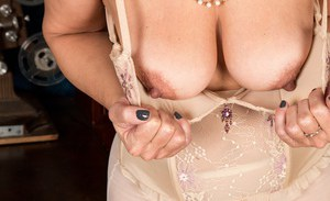 Older lady Kaysy strips off skirt and blouse to pose for lingerie spread