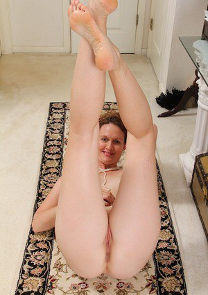 Mature dame Ajia Simpson rolls pantyhose down legs to spread vagina