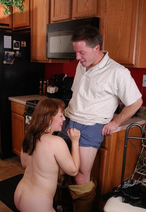 Chubby redhead in nylons eating jizz after giving blowjob in kitchen
