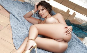 Brunette babe Candace Leilani exposes large tits for centerfold spread