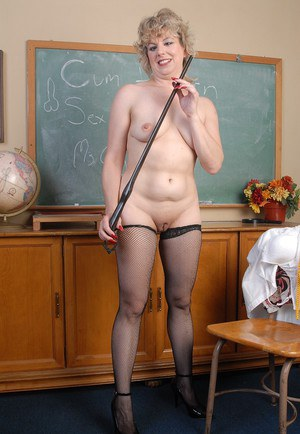Stocking clad older blonde teacher strips in classroom to spread bald cunt