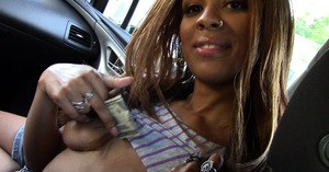 Ebony solo girl exposes pierced nipples and shaved pussy in vehicle