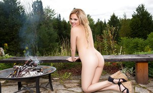 Blonde centerfold babe Richelle Taylor exposing nice teen tits outdoors