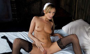 Pornstar Pristine Edge modeling in stockings and nurse cap for babe shoot