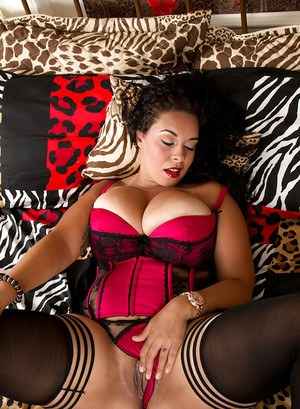 Stocking attired brunette BBW Anastasia Lux freeing huge tits from lingerie