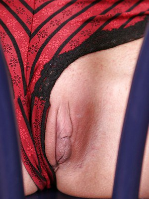 Stocking and lingerie attired blonde babe Veronika G flashing shaved pussy