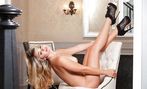 Blonde centerfold babe Tahlia Paris unveils large boobs in skirt and heels