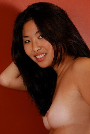 Amateur Asian solo girl with tiny breasts spreads shaved vagina