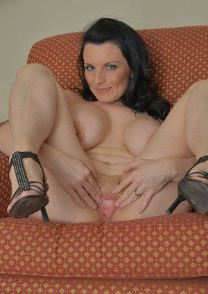 Dark haired babe Stacy Ray frees big MILF tits and ass from sheer lingerie