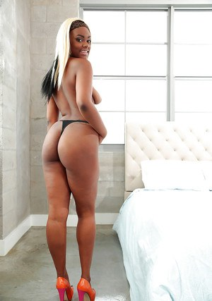 Black babe Lucy Raquel shedding pantyhose to expose phat booty