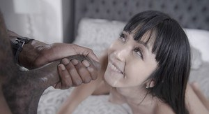 Brunette Asian MILF Marica Hase delivering interracial blowjob