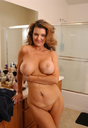 Mature lady with huge melons and shaved pussy caught naked in shower