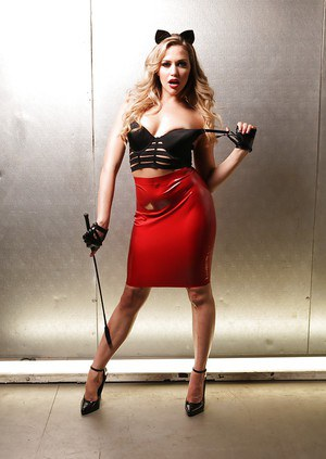 Solo girl Mia Malkova flaunting phat ass in latex skirt and high heels