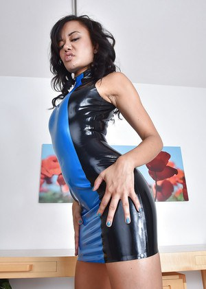 Asian solo girl Annie Cruz revealing pierced MILF pussy beneath latex dress
