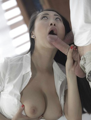 Busty Asian office worker in skirt and blouse takes cumshot after giving bj