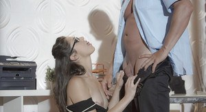 Glasses adorned brunette office worker Anna Morna licking and sucking cock