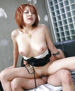 Redhead Asian chick with big natural tits taking hardcore beaver fingering