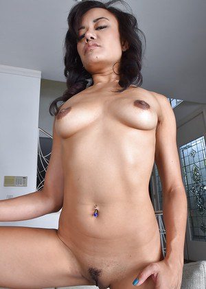 Asian solo girl Annie Cruz revealing tiny MILF tits and hairy snatch