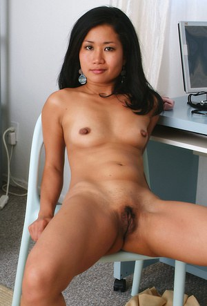 Amateur Asian babe strips naked in office for tiny tits and pussy exposure