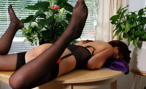 Latina first timer in stockings and garters spreading labia lips in office