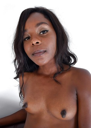 Older black lady bares small breasts before slipping jeans over phat booty