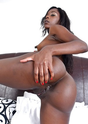 Mature ebony woman with tiny boobs baring nice ass before spreading pussy