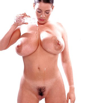 Brunette mom Linsey Dawn McKenzie oiling massive juggs, beaver and ass