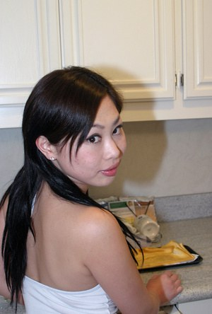 Asian first timer sliding panties over ass in kitchen for twat spreading