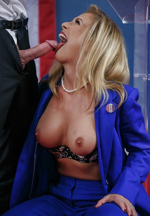 Blonde MILF pornstar Cherie Deville baring big boobs while blowing cock