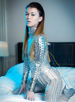 Collared Euro babe Misha Cross freeing tiny tits from freaky fetish garb